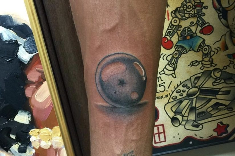 Black and grey tattoo of a Dragon Ball