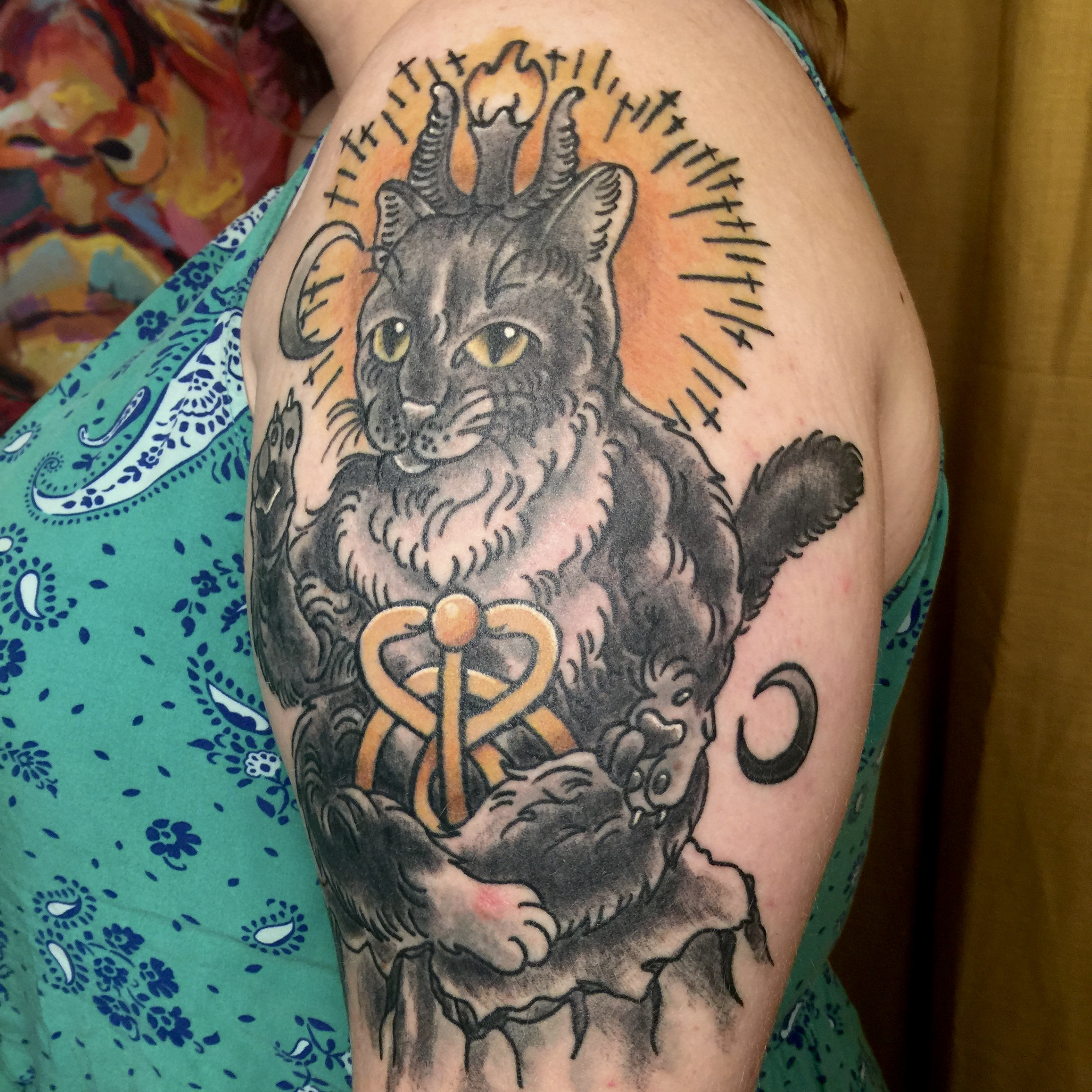 A tattoo of Baphomet as a cat